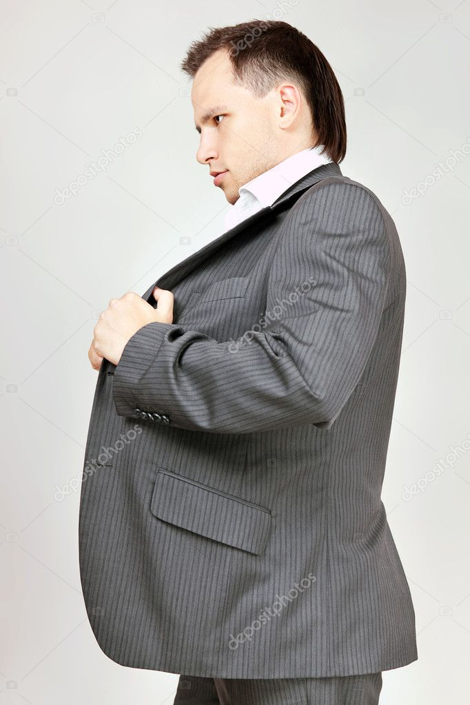 Businessman set straight his coat  Stock Photo #8206404