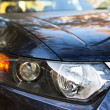 Aggressive looking, car headlight closeup — Stock Photo