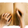 Hands writing in the book — Foto de Stock