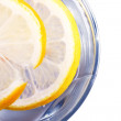Royalty-Free Stock Photo: Glass full of drink with lemon