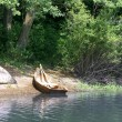 Boat on the river bank - Stock Photo