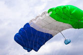 Skydiver flying in bright blue sky. — Stock Photo