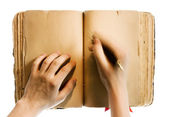 Hands writing in the book — Stock Photo