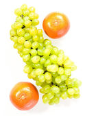 Oranges and grapes — Stock Photo