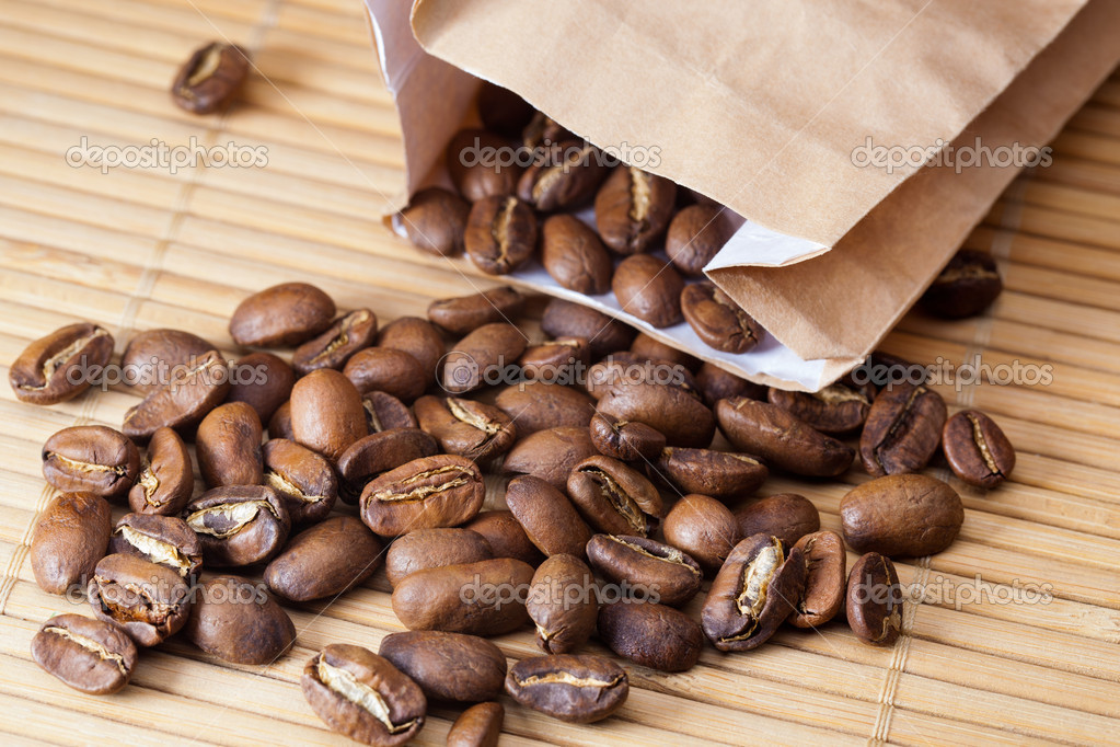 Coffee grains were scattered from a package — Stock Photo #10690622