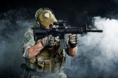 A soldier in the smoke after the explosion — Stock Photo