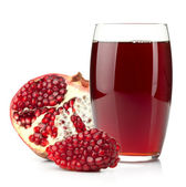 Pomegranate juice in a glass and ripe pomegranate — Stock Photo
