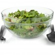 Healthy green salad with plastic utensils — Stock Photo