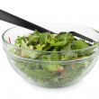 Healthy green salad with plastic fork — Stock Photo