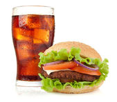 Glass of cola with ice and hamburger — Stock Photo