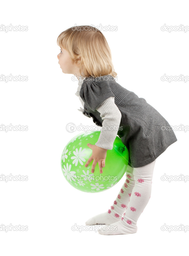 Baby girl with a green balloon. Isolated on white background — Stock Photo #9630274