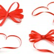 Stock Photo: Red heart and ribbon bow isolated on white background