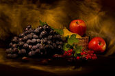 Still life with autumn vegetables and fruits on black background — Stock Photo