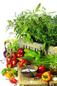 Herbs in the box and fresh vegetables — Stock Photo