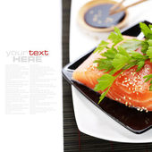 Fresh salmon and soy sause — Stock Photo