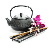 Tea pot and chopsticks — Stock Photo