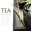 Green tea and chopsticks — Stock Photo