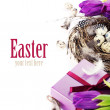 Easter eggs with purple tulip flowers and gifts — Stock Photo