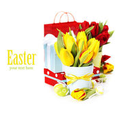 Spring tulips with easter eggs — Stock Photo