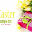 Easter eggs with yellow tulip flowers and gift box — 图库照片