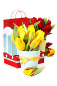 Gift boxes and fresh flowers — Stock Photo