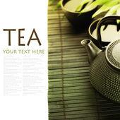 Green tea and chopsticks — Stock Photo