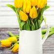Yellow tulips in a vase — Stock Photo #9553445