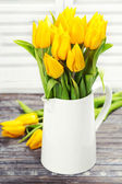 Yellow tulips in a vase — Stok fotoğraf