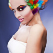 Beautiful young female face with bright fashion multicolored make-up & — Stock Photo