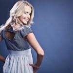Studio fashion photo of beautiful young woman in elegance dress. — Stock Photo