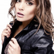 Beautiful young woman on leather jacket. - Stok fotoğraf