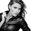 Beautiful young woman on leather jacket. - Stockfoto