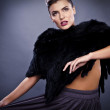 Portrait of stylish&fashionable pretty woman in fur - Stok fotoğraf