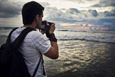 Travel photographer with digital camera — Stock Photo