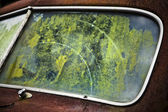 The old car window with reflection of trees — Stock Photo