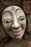 Old wooden face on roots - conceptual background. — Stock Photo