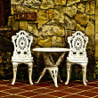 Vintage chair and table in front yard — Stock Photo #9112614