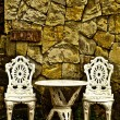 Vintage chair and table in front yard — Stock Photo
