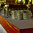 Clean dishes on wooden table - Stock Photo