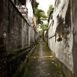 A narrow street between houses - Stock Photo