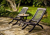 Chairs and table in the garden — Stock Photo
