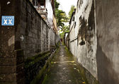 A narrow street between houses — Stock Photo