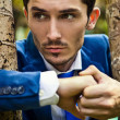 Portrait of a good looking beautiful young man in costume outdoors. — Stock Photo