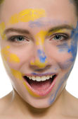 Smiling woman with paint on his face — Stock Photo