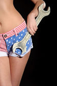 Woman in shorts colors of USA flag with wrench — Stock Photo