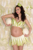 Pregnant woman in lingerie from lettuce — Stock Photo