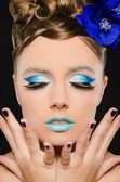 Vertical portrait of woman with blue make-up — Stock Photo