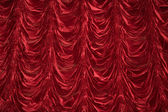 Theatrical curtain of red color — Stock Photo