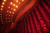 Theater stage with red curtain — Stock Photo