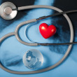 Stethoscope and heart on X-ray - Stock Photo